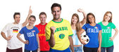 Laughing sports fan from Brazil with fans from other countries — Stock Photo