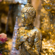 Thai buddha statue cover with gold leaf — Stock Photo