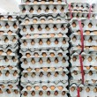 Stacked of eggs for wholesale at the market — Stock Photo