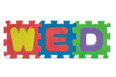 Word WED formed with colorful foam puzzle toy isolated on white — Stock Photo