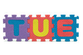 Word TUE formed with colorful foam puzzle toy isolated on white — Stok fotoğraf