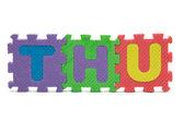 Per ile üzerine beyaz izole renkli köpük bulmaca oyuncak oluşan kelime — Stok fotoğraf
