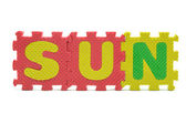 Word SUN formed with colorful foam puzzle toy isolated on white — Stockfoto