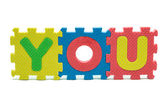Word YOU formed with colorful foam puzzle toy isolated on white — Stockfoto