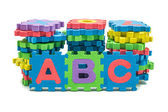 Alphabet colorful foam puzzle mat isolated on white background — 图库照片