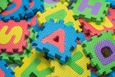 Colorful foam puzzle mat isolated on white background — 图库照片