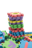 Tower of colorful alphabet puzzle mat isolated in white backgrou — 图库照片