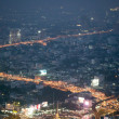 Abstract Bangkok city traffic light nightscape — Stock Photo #38682863