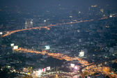 Abstract Bangkok city traffic light nightscape — Stock Photo