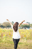Back view of Asian girl in the sunflower field — Stockfoto