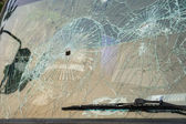 Car with bullet holes in the windshield — Stock Photo