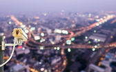 Backview of CCTV Camera with nightscape of Bangkok city, Thailand — Stock Photo