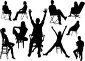 Sitting people silhouettes — Stock vektor