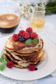 Pancakes with berries and coffee — Stock Photo