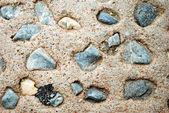 Rock and sand on the beach — Stok fotoğraf