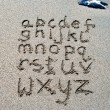 Hand written on sand beach — Stock Photo #32901377