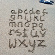 Stock Photo: Hand written on sand beach