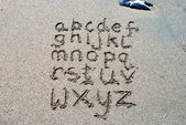 Hand written on sand beach — Stok fotoğraf