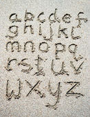 Hand written on sand beach — ストック写真