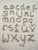 Mano scritto sulla spiaggia di sabbia — Foto Stock