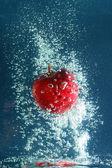 Apple in splash of water — Foto Stock