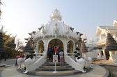 CHIANGRAI, THAILAND - MAR 2: Unidentified travelers visit Wat Rong Khun a famous white temple at northen thailand on 2 March 2014 at Wat Rong Khun, Chaingrai, Thailand. — Стоковое фото