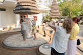 CHIANGRAI, THAILAND - MAR 2: Unidentified travelers visit Wat Rong Khun a famous white temple at northen thailand on 2 March 2014 at Wat Rong Khun, Chaingrai, Thailand. — Stok fotoğraf