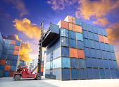 Forklift handling the container box at dockyard with beautiful s — Stockfoto