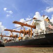 Stock Photo: Cargo ship at the port with blue sky