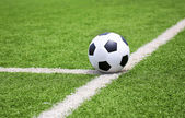 Soccer football on green grass field — Stock Photo