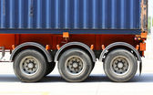 Truck with blue container in shipping location — Stock Photo