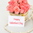 Pink roses with note paper for valentine's day — Stock Photo #40495551