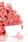 Pink roses with note paper on white background — Stock Photo