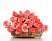 Pink roses in wooden basket — Stock Photo