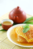 Sweet honeycombs with tea  — Stock Photo