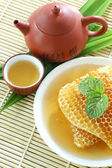 Sweet honeycombs with tea  — Stok fotoğraf