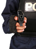 Undercover policeman wearing a hood balaclava, aiming at your fa — Stock Photo