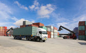 Container truck at dockyard with forklift background and blue sky — Stock Photo