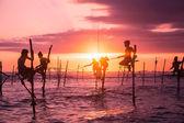 Fishermen fishing in unique style — Stock Photo