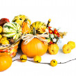 Autumn pumpkins and quitte on white background — Stock Photo