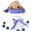 Blueberry cupcake on a decorated plate isolated on white — Stock Photo