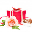Gift box, a rose and cookies on white background — Stock Photo
