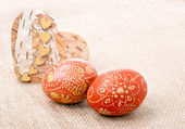 Easter eggs on a rough sackcloth — Stock Photo