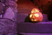 Halloween pumpkin on the stairs — Stock Photo