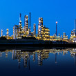 Modern factory reflected in a lake at night — Stockfoto