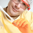 Young microbiologist in protective gear — Stock Photo
