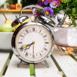 Old alarm clock on wooden table — Foto Stock