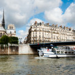 Paris, passenger boat on river Seine — Stock Photo #33383243