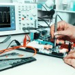 Stock Photo: Tech tests electronic equipment