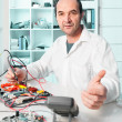 Senior radioelectronics repair tech — Stock Photo